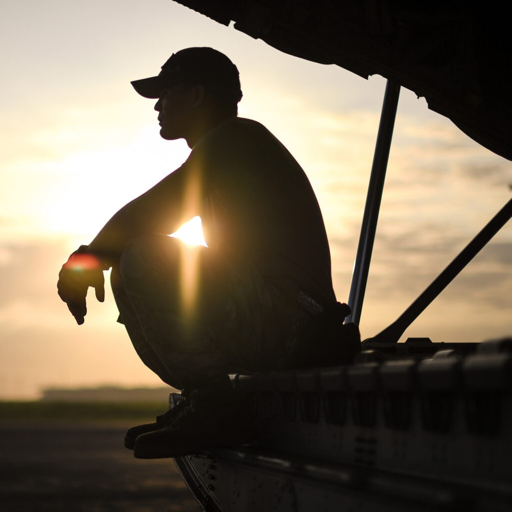 An Air Force Noncommissioned Officer rests on the ramp of a C-130J Hercules before a mission departing Maputo International Airport, Mozambique, March 30, 2019. U.S. Air Force photo by Staff Sgt. Corban Lundborg