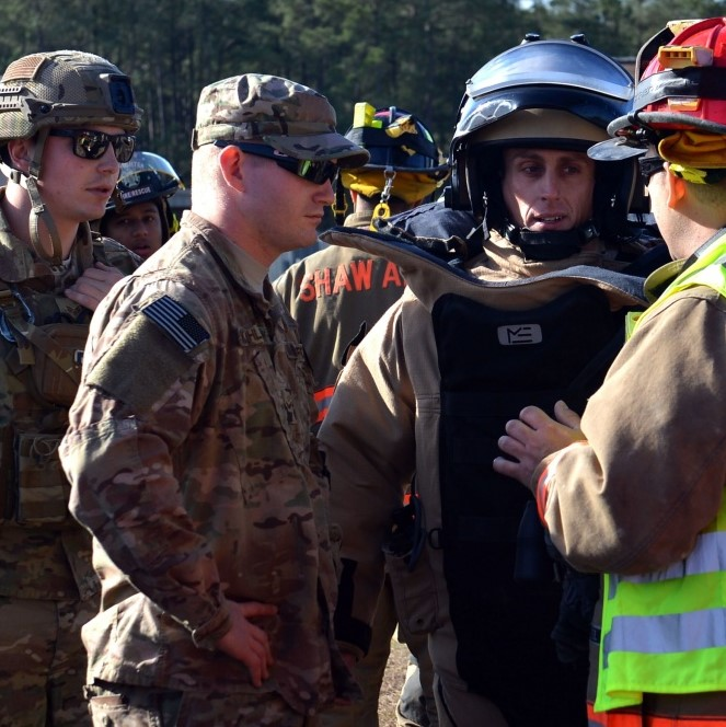 U.S. Airmen discuss a plan of action before participating in a joint hazardous material training at Shaw Air Force Base, S.C., Jan. 19, 2017. (U.S. Air Force photo by Airman 1st Class Christopher Maldonado)