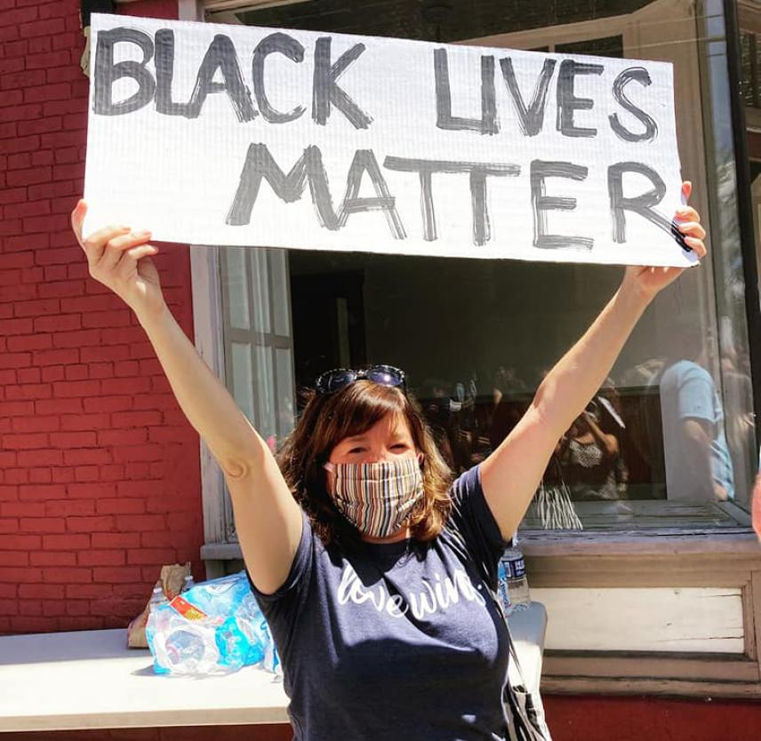 Nicole holding up Black Lives Matter sign.