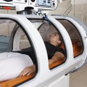 Woman getting hyperbaric oxygen therapy treatment.