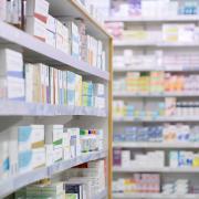 Pharmacy shelves of medication.