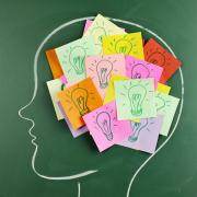 Drawn profile of a head with sticky notes showing lightbulbs.