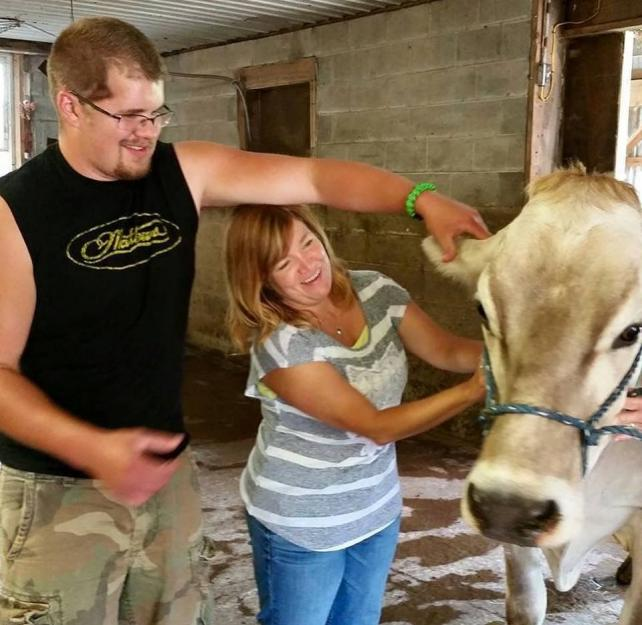 Nicole petting a cow