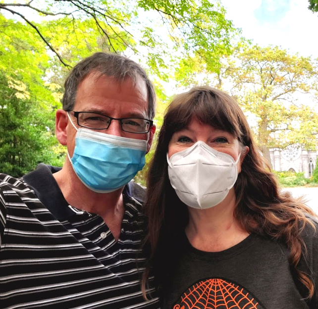 David Grant and his wife smiling in face masks