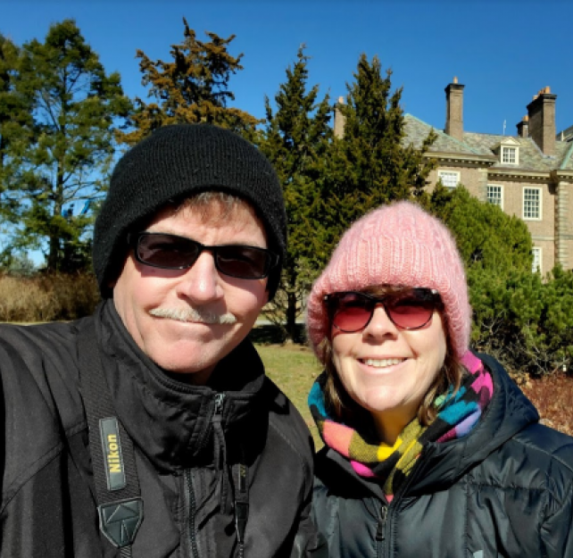David Grant and his wife smiling in sunglasses