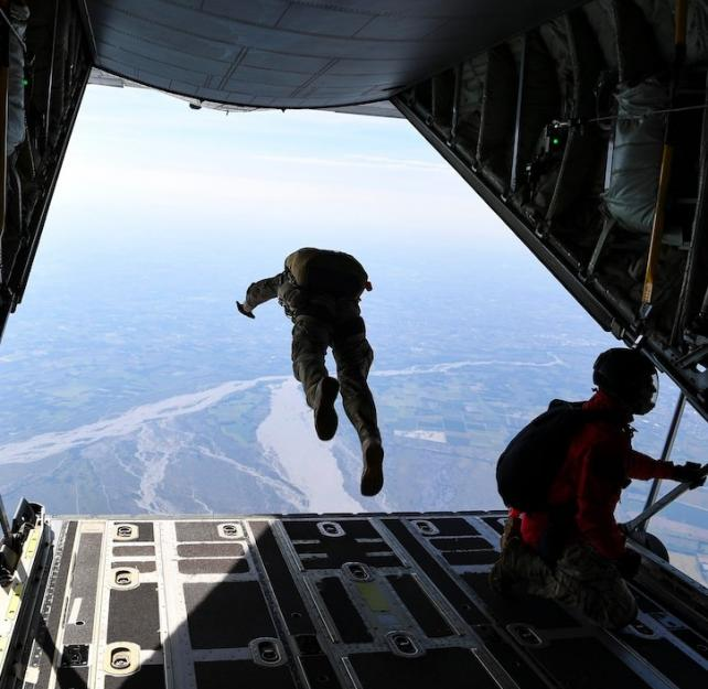 A service member jumps out of an Air Force C-130J Hercules during a military freefall jumpmaster course over Aviano Air Base, Italy, Sept. 11, 2020. DoD Photo By: Air Force Senior Airman Savannah Waters